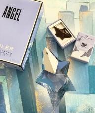 Thierry Mugler и готвачът Nicolas Cloiseau от La Maison Du Chocolat по повод 25-тата годишнина на парфюма, пускат кутия шоколадови бонбони с вкус на Angel.  - Парфюми Фрагрисима